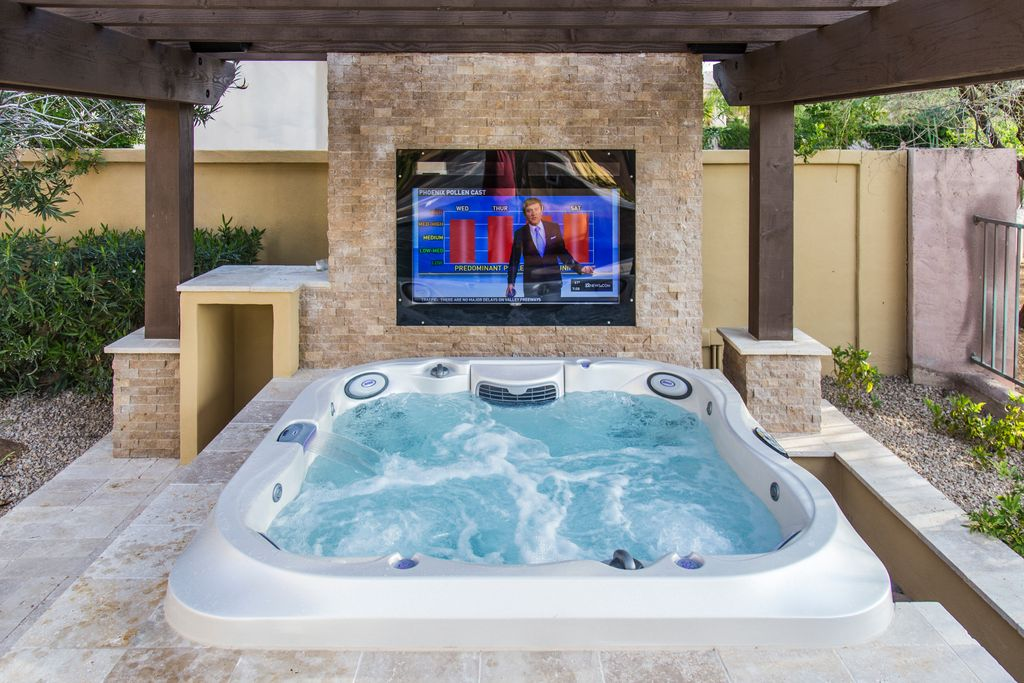 traditional hot tub with fence trellis exterior stone floors exterior tile floors