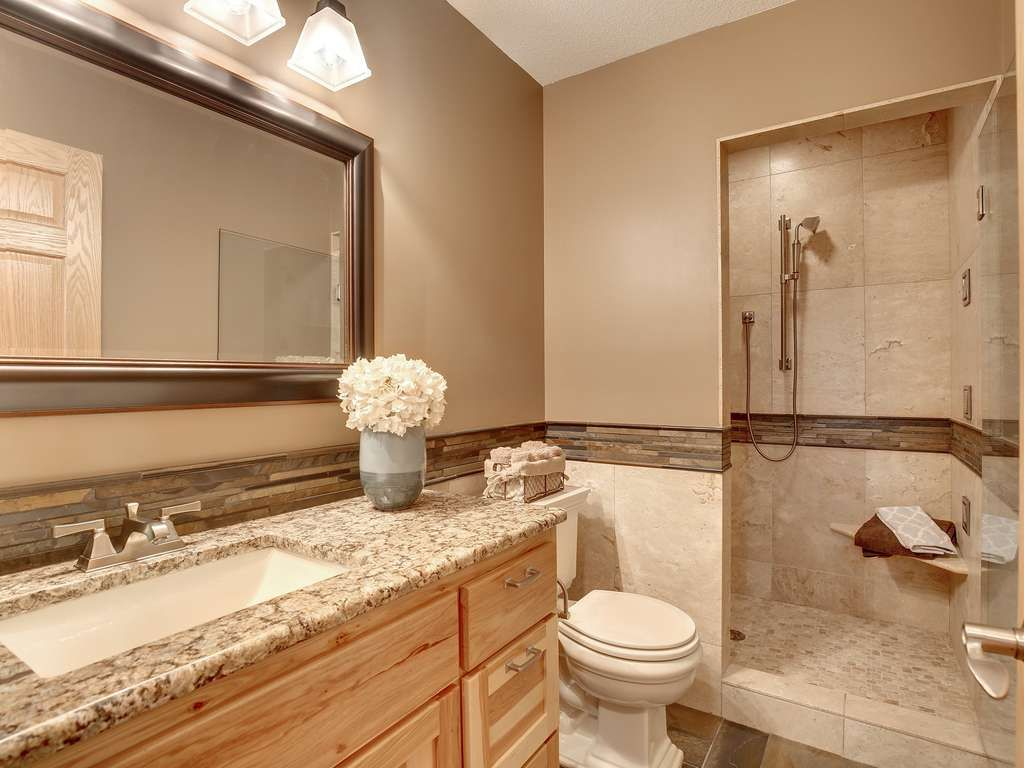 natural bathroom tiles traditional 3 4 bathroom with flat panel cabinets amp slate 13789