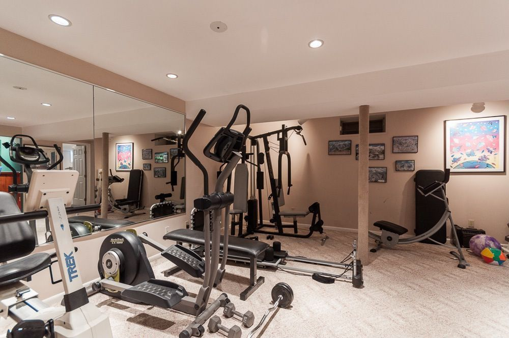 Traditional home gym with carpet columns in downingtown for Home designs by marcy