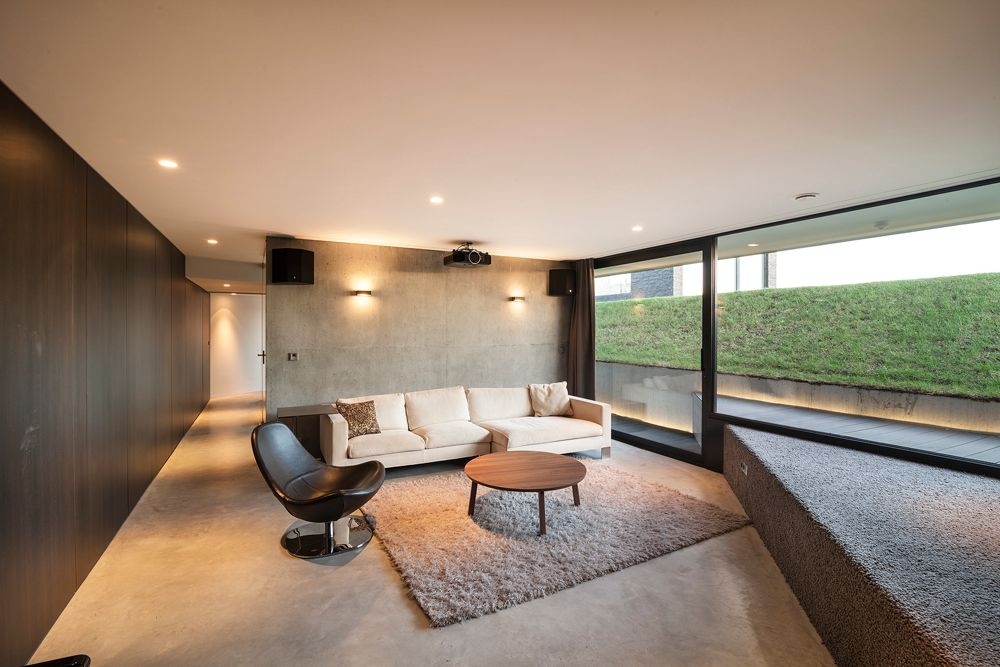 Modern Living Room with Concrete wall by Home Stratosphere Zillow Digs Zillow