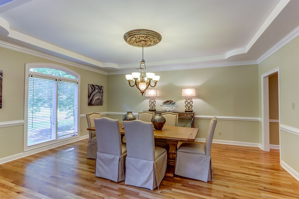 Traditional Dining Room With Chair Rail Hardwood Floors Chandelier Crown Molding High