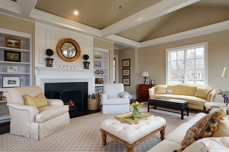 Traditional Living Room with Built-in bookshelf & Cement fireplace ...