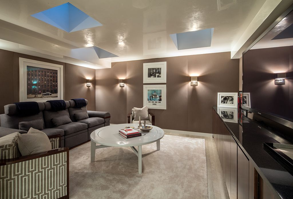 Contemporary Living Room with Wall sconce, Pottery Barn Henley Rug - Ivory,  Skylight,