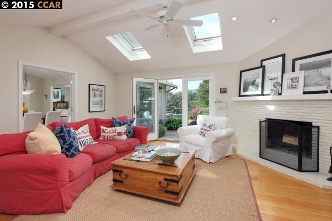 cottage living room with cathedral ceiling  u0026 skylight in