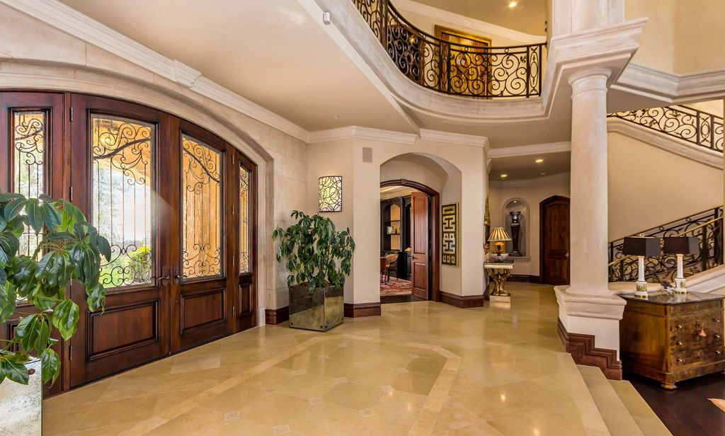 1 Tag Mediterranean Entryway With Columns, Limestone Tile Floors, Crown  Molding, High Ceiling