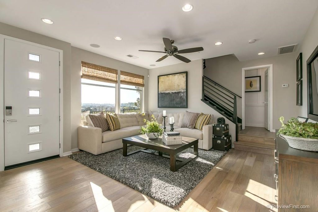 Source Living Room With Carpet Hardwood Floors In San Diego CA