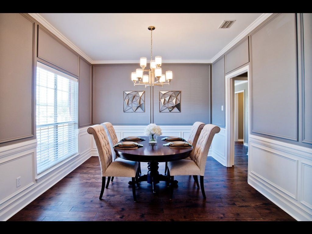 Traditional dining room with wainscoting by simply southern staging traditional dining room with wainscoting crown molding high ceiling chandelier hardwood floors arubaitofo Images