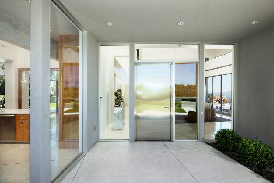 Modern Front Door with exterior tile floors by doron dreksler ...