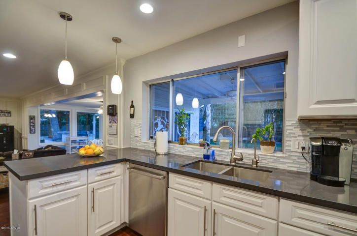 Marvelous Contemporary Kitchen With Raised Panel, Lava Rock Solid Surface Countertop,  Corian, Hardwood Floors