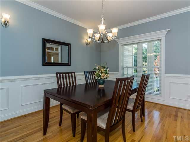 Traditional Dining Room With Chair Rail Hardwood Floors Wainscoting Crown Molding Wall