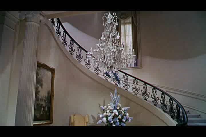 Chair Rail Staircase Part - 41: Traditional Staircase With Columns, Chandelier, Carpet, Chair Rail,  Wainscoting, Cathedral Ceiling