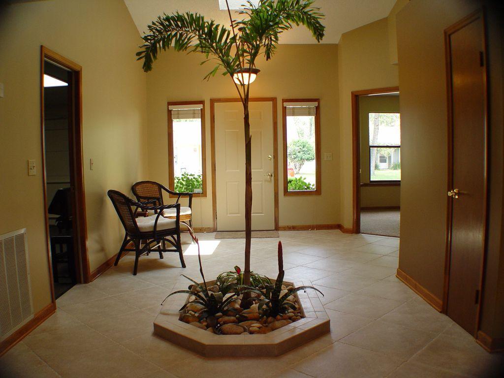 Tropical entryway with skylight pendant light in jacksonville tropical entryway with limestone tile floors high ceiling pendant light skylight dailygadgetfo Choice Image