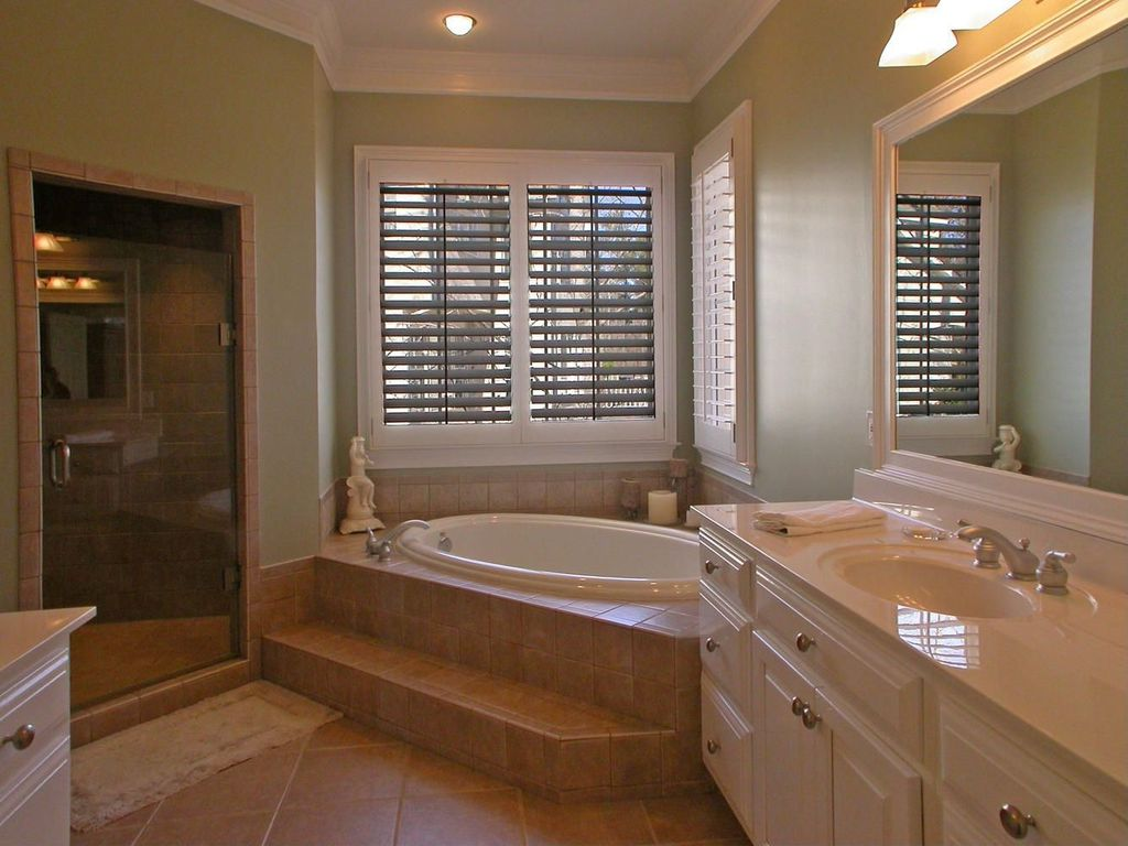 Crown molding in bathrooms - Traditional Master Bathroom With Limestone Counters Flush Light Drop In Bathtub Frameless