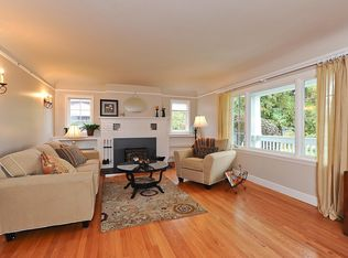 Traditional Living Room With Cement Fireplace Amp Carpet In