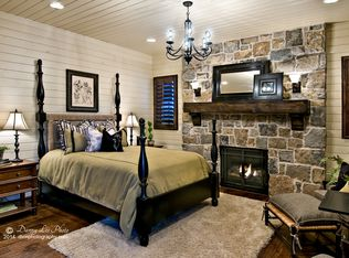 country master bedroom with chandelier high ceiling in