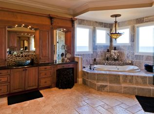 Mediterranean Powder Room With French Doors Amp Wall Sconce