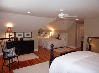 Cottage Guest Bedroom With Laminate Floors In Edgartown