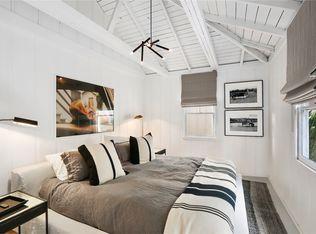 Modern Guest Bedroom with Chandelier Exposed beam in Laguna