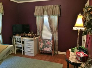 Cottage Living Room With Crown Molding Amp High Ceiling In