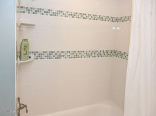 Cottage Full Bathroom With Wainscoting Amp Wall Sconce In