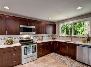Contemporary Kitchen With Limestone Tile Amp Corian Counters