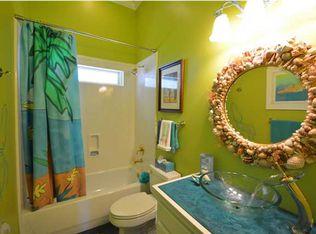 Tropical Kids Bathroom With Stone Slab Showerbath