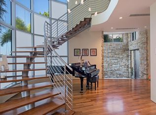 Contemporary Staircase With High Ceiling Amp Hardwood Floors