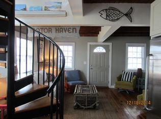 Cottage Living Room With Plantation Shutters Amp Spiral