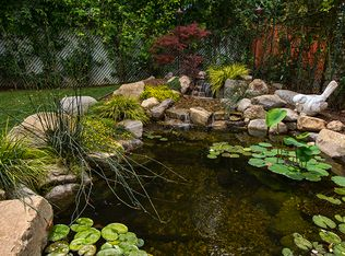 Contemporary landscape and yard with pond fence in san for Koi pool singleton