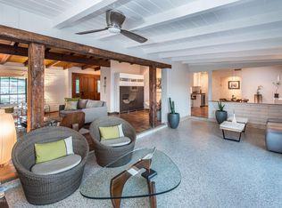 Living Room With Terracotta Tile Floors Skylight In