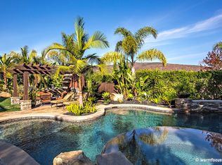 Tropical Swimming Pool With Exterior Stone Floors Fence In Carlsbad Ca Zillow Digs Zillow