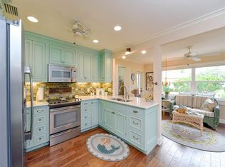 country kitchen with flat panel cabinets ceiling fan in