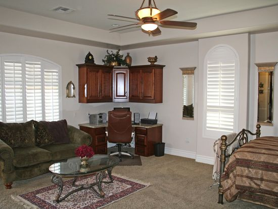 Traditional Living Room with High ceiling & Ceiling fan in GILBERT
