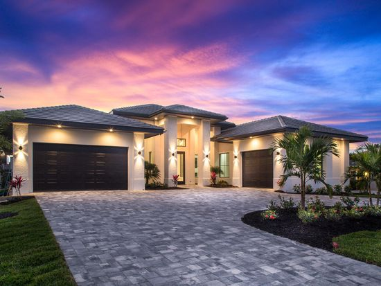 The jolie cape coral yacht club area by tudor villas for Modern florida homes