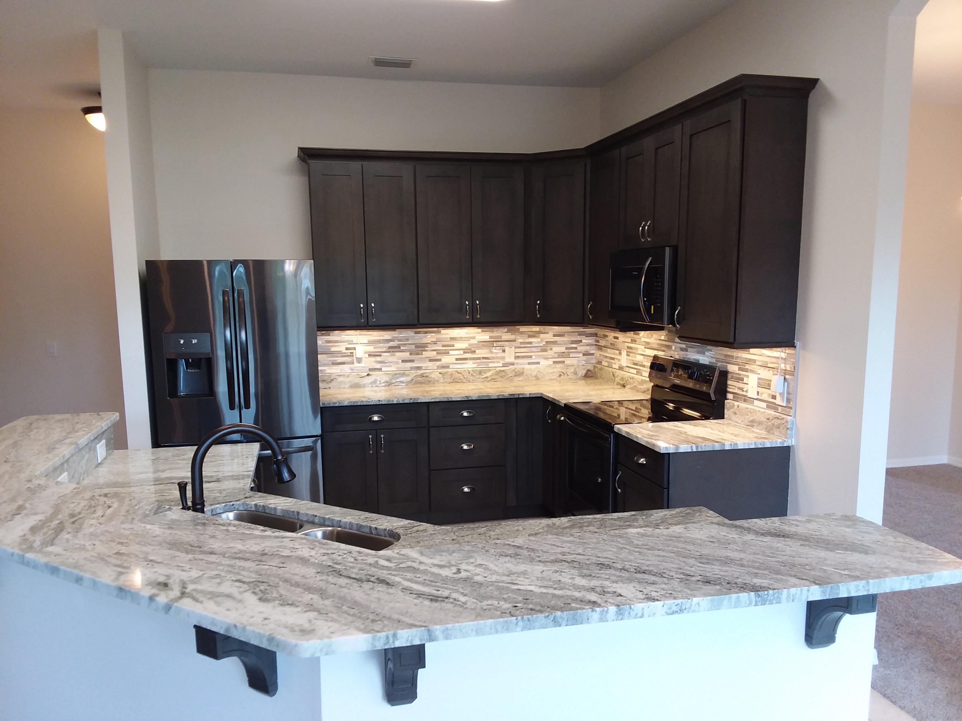 kitchen berwyn perimeter with granite cambria pin quartz and fl countertops island naples